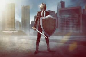 Defend your business against the effects of the coronavirus - business man in with a shield, sword, helmet.