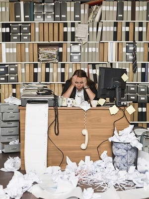 Maryco Cleaning Service: We clean consulting firms near Indianapolis (woman consultant at her desk with a lot of trash and a messy office)